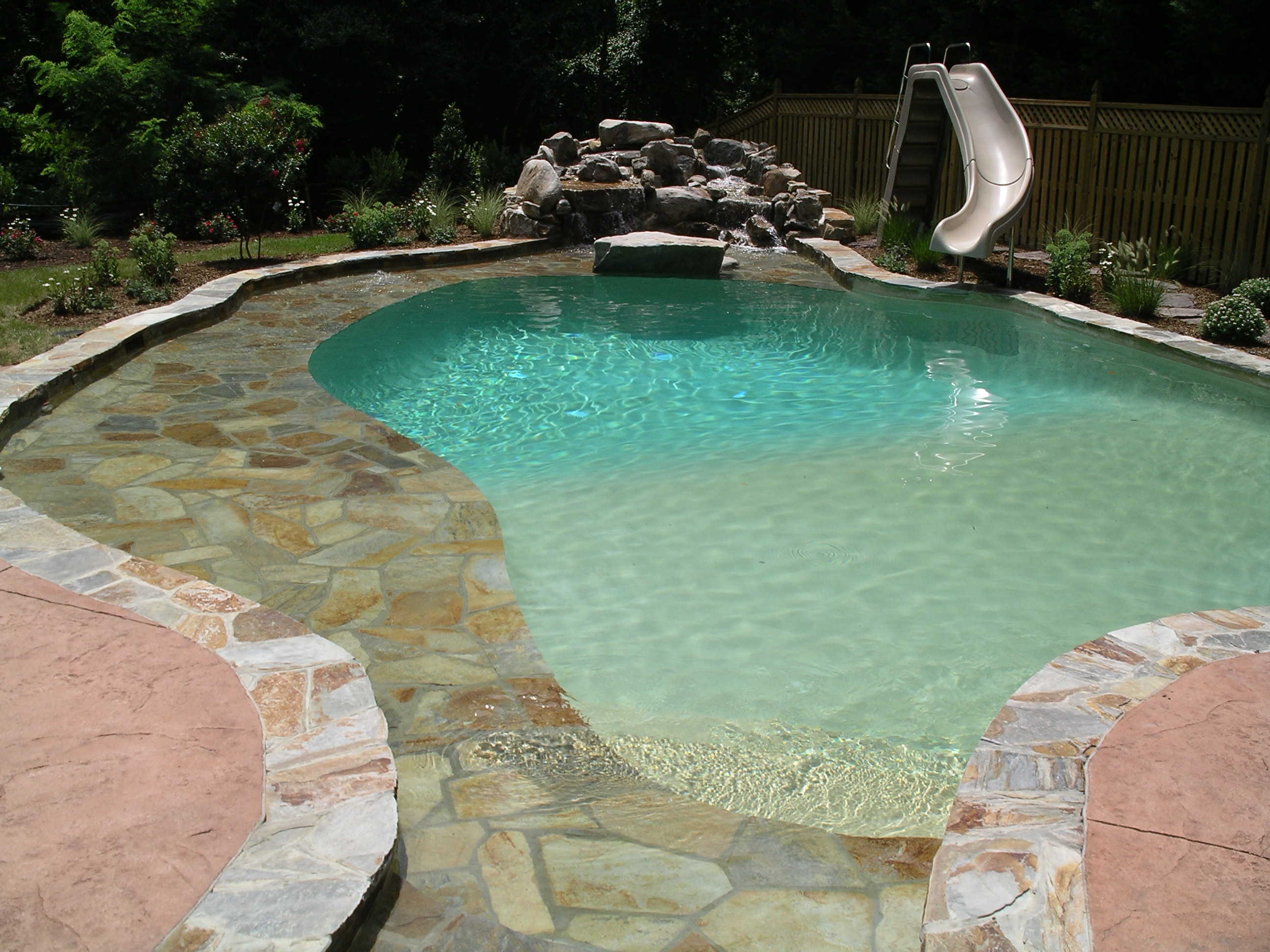 in-ground pool with slide
