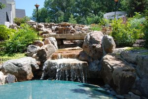 in-ground pool waterfall feature