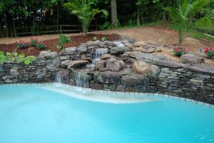 in-ground pool waterfall
